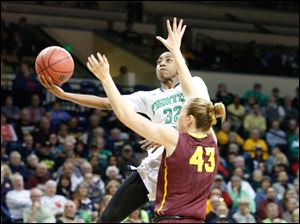 UND's Jewel Loyd shooting over ASU's #43, Eliza Normen in the second half. Loyd would score 19 points with seven rebounds.