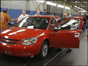 Workers at the  Lordstown, Ohio, Assembly Plant work on the Chevrolet Cobalt in 2008. The next year GM engineers were informed data in the Cobalt's black box showed an ignition switch fault.