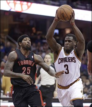 Cleveland Cavaliers' Dion Waiters (3) drives past Toronto Raptors' John Salmons (25) during the second quarter.