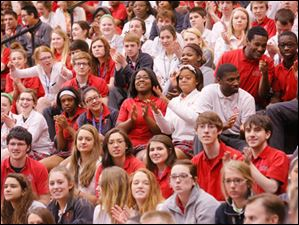 Central Catholic High School students applaud the new citizens.