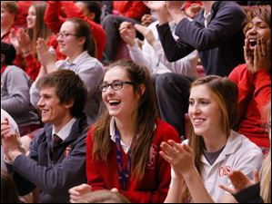 Central Catholic High School students cheer for the new citizens.