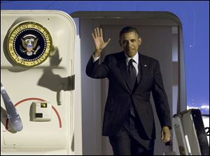 U.S. President Obama waves as arrives from Air Force One at Zaventem airport in Brussels on Tuesday.