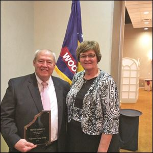 Jack Jones of Poggemeyer Design Groups stands next to Wood County Commissioner Doris Herringshaw at the Wood County Economic Development Commission's awards dinner.