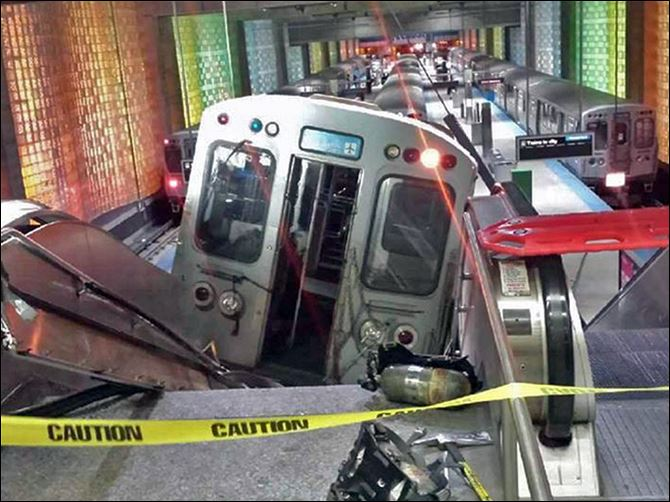 Chicago Train Derailment A Chicago Transit Authority train car rests on an escalator at the O'Hare Airport station after it derailed early Monday morning.