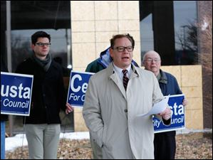 Joe Celusta announces his candidacy for Toledo City Council District 2 standing in front of the boarded-up former Clarion Hotel on Reynolds Road.