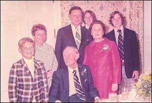 At a family 50th anniversary celebration at the Toledo Club in 1973, Joe Celusta, front left in the plaid jacket, who is now running for Toledo City Council, stands beside his grandfather Ollie Czelusta, who was Toledo mayor from 1950-51 and 1954-57. Behind them are, from left, Nancy Celusta, John Ollie Celusta, Chris Aloysuis Celusta, Josephine Czelusta, and John Andrew Celusta. The younger generation spells their last name differently from their ancestors.