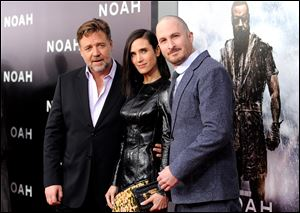 "Actors Russell Crowe, left, and Jennifer Connelly pose with director Darren Aronofsky at the premiere of ""Noah."""