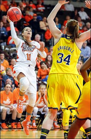Bowling Green State University's Jillian Halfhill shoots over Michigan's Val Driscoll during the second half at Bowling Green. Halfhill scored 18 points before 2,403 fans at the Stroh Center. The Falcons will play Rutgers in Bowling Green on Monday.