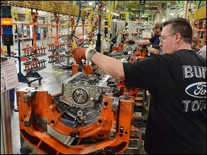 John Wooten places pistons into the new 2.7-liter EcoBoost engine on the assembly line  at Ford's Lima Engine Plant Friday. Production of the twin-turbo-charged engine designed specifically for the F-150 pickup is expected to begin this fall.