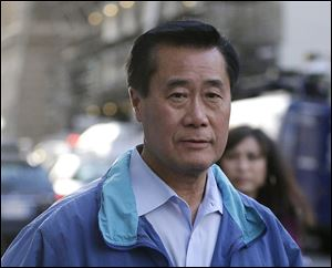 California Sen. Leland Yee, D-San Francisco leaves the San Francisco Federal Building, Wednesday. The FBI has filed a 137-page affidavit outlining a detailed corruption case against Yee, who is accused of asking for campaign donations in exchange for introducing an undercover agent to an arms trafficker.