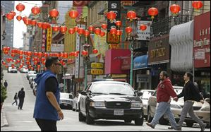 San Francisco police patrol the Chinatown district Thursday.