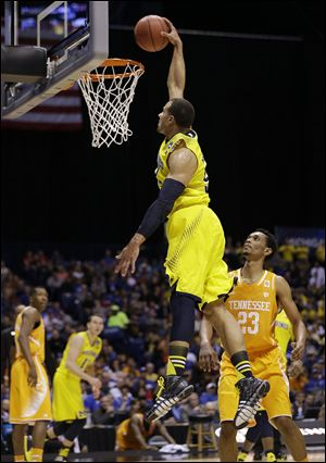 Michigan's Jordan Morgan goes up for a dunk during the first half against Tennessee on Friday. The Wolverines advance to the Elite Eight for the second season in a row.