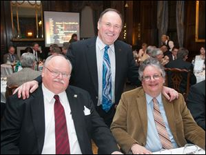 Dave DePasse, Art Bronson, event chairman, and Rich Rothrock at The Toledo Club Scotch Night.