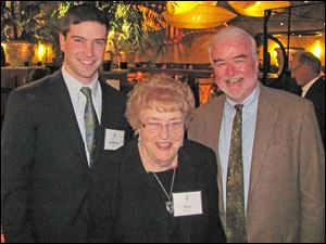 Tom McHugh's son, Brendan, Tom McHugh's mom, Posy, and Tom McHugh, of Heidleberg Distributing, which donated the wines. He is an alumnus.