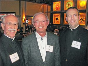 Father Ron Olszewski, school president; Mike Gibbons of Main Street Ventures which hosted the event, and Fr. Geoff Rose, president-elect.