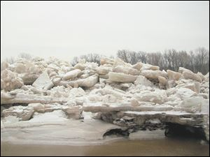 An ice shove about 15 feet high, above, buried the lower tow path at Side Cut Metropark along the Maumee River in late February.