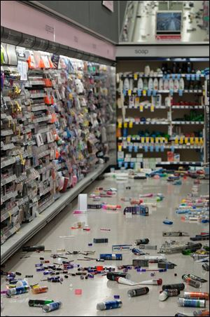 Merchandise is strewn across the floor in a La Habra Walgreens following a 5.1 earthquake centered near La Habra Friday night.