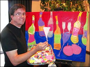 Artist Greg Justus works on a painting during the Starry Night Wine & Art Gala that will be included in the auction.