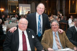 DAVE DEPASSE, left, ART BRONSON, event chairman, center, and RICH ROTHROCK at the Toledo Club Scotch Night.