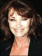 British actress Kate O'Mara poses for photographers in 1998.