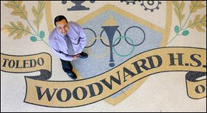 Former Woodward High School principal Emilio Ramirez earned his place in the school's hall of fame through his leadership when the old building was razed and students and staff moved into the new building a 100 feet away in 2010.