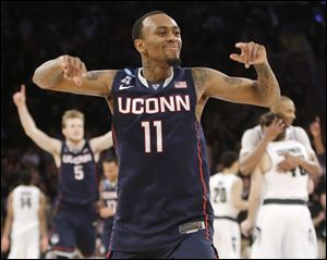 Connecticut's Ryan Boatright celebrates after his team defeated Michigan State 60-54 in a regional final Sunday in New York.