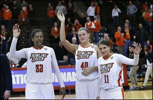 BGSU seniors, from left, Alexis Rogers, Jill Stein, and Jillian Halfhill wave good-bye to fans after their loss to Rutgers in the WNIT on Monday. The Falcons won 30 games this season, the second-highest total in Mid-American Conference history.