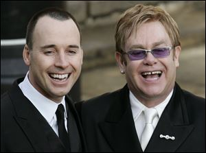 British musician Elton John , right, and his longtime partner David Furnish in 2005.
