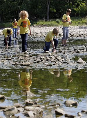 Volunteers from Toledo ZooTeens take part in last year's river cleanup.