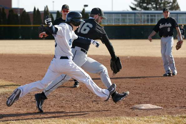 Lake-s-Aaron-Witt-is-beat-to-1st-base-by-Perrysburg-pitcher-AJ-Stockwell
