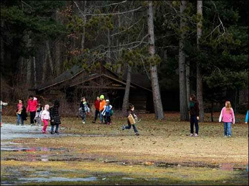 Campers participate in a scavenger hunt during a Spring Break Day Camp sponsored by the Girl Scouts at Camp Miakonda in Sylvania,
