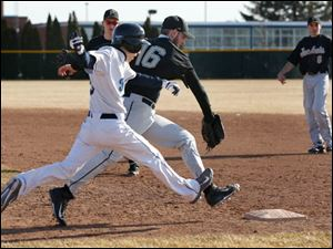 Lake's Aaron Witt is beat to 1st base by Perrysburg pitcher AJ Stockwell.