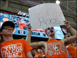 Fans root for BGSU women's basketball coach Jennifer Roos during 4th round WNIT game.