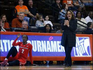 Rutgers' Kahleah Copper waits to be put in the game by head coach C. Vivian Stringer during 2nd half.