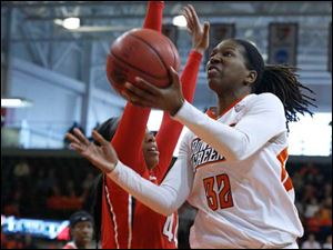 Rutgers' Betnijah Laney defends BGSU's Alexis Rogers during 4th round of WNIT game at BGSU's Stroh Center.