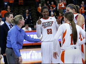 BGSU head coach Jennifer Roos talks to the three seniors on the team after their defeat by Rutgers in a 4th round WNIT game at BGSU's Stroh Center. Players from left: Alexis Rogers, Jillian Halfhill, and Jill Stein.