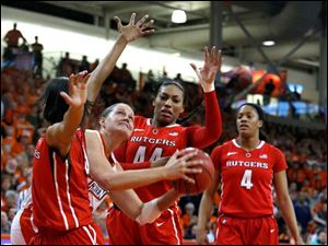 BG senior Jill Stein goes up between Rutgers' Tyler Scaife, left, and Betnijah Laney.
