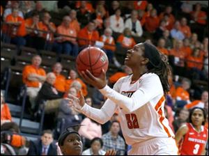 BGSU's Alexis Rogers shoots over Rutgers' Syessence Davis during 2nd half.