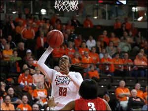 BGSU's Alexis Rogers shoots over Rutgers' Tyler Scaife during 2nd half.