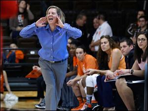 BGSU head coach Jennifer Roos calls to her players on the court.