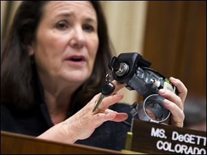 Rep. Diana DeGette (D., Colo.), ranking member of the House Oversight and Investigations subcommittee, holds up a GM ignition switch while she questions General Motors CEO Mary Barra on Capitol Hill on Tuesday.