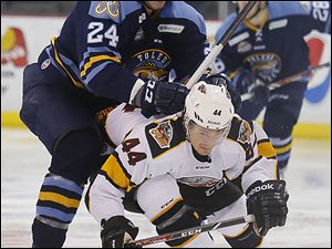 Toledo Walleye player Richard Nedomlel, shoving Cincinnati Cyclones' Jonathan Hazen, says he plays hard to protect his teammates. Nedomlel says he was big for his age and thus played meaner and more aggressively back home in the Czech Republic.