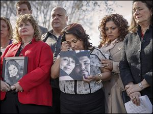 Rosie Cortinas, center, holds a photo of her son, Amador Cortinas of Homedale, Idaho, who was killed driving a Chevy Cobalt. She joined other grieving families on Capitol Hill with U.S. Rep. Diana DeGette (D., Colo.), right.