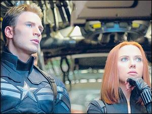 Chris Evans and Scarlett Johansson reprise their roles as Captain America and Black Widow in 'Captain America: The Winter Soldier.'