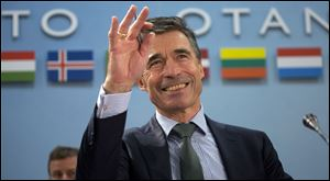NATO Secretary General Anders Fogh Rasmussen gestures during a meeting of the North Atlantic Council at NATO headquarters in Brussels on today. NATO foreign ministers begin a two-day meeting in which they will discuss, among other issues, the situation in Ukraine.