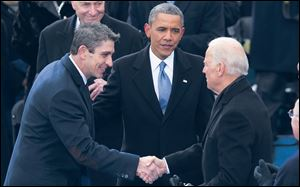 Richard Blanco meets with President Obama and Vice President Biden at the inauguration Jan. 13, 2013 in Washington.