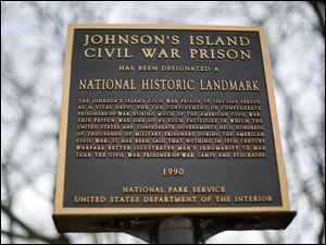 An historical plaque in placed at the entry way to the excavation area for Johnson's Island Civil War Prison.
