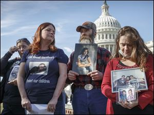 Mary Ruddy, right, of Carbondale, Pa., whose daughter Kelly, 21, was killed in 2010 while driving a 2005 Cobalt, and other relatives of people who were killed while driving the Chevrolet car  gather on Capitol Hill in Washington this week.