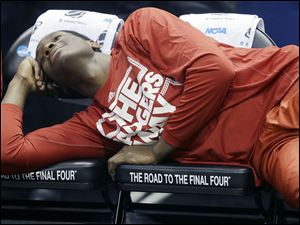 Wisconsin forward Nigel Hayes lays on the bench to relax before an NCAA tournament game. The Badgers play Kentucky on Saturday.