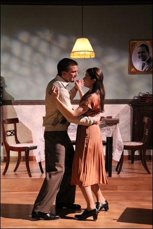 Tanner DuVall as Jim O'Connor and Elizabeth Cottle as Laura Wingfield in a scene from the Rep's production of 'The Glass Menagerie.'